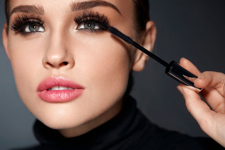 Beauty. Beautiful Woman Applying Black Mascara On Eyelashes