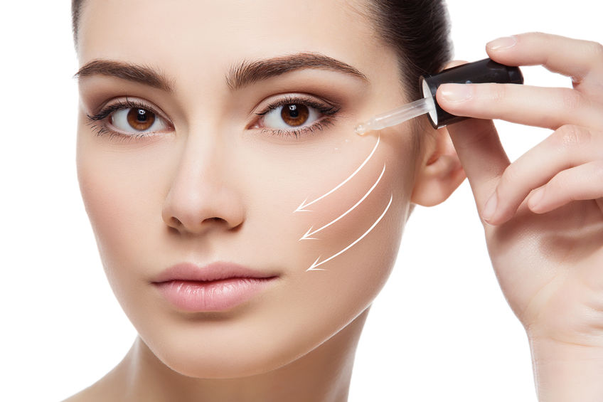 Girl applying anti wrinkle serum